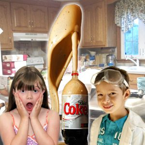 Two Children with Coke-Bottle Science Experiment at Home