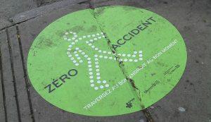 """""""Zero accidents"""" sticker on sidewalk"""